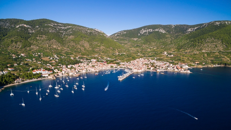 Aerial view of Komiza town and boats docked in marina on Vis Isl